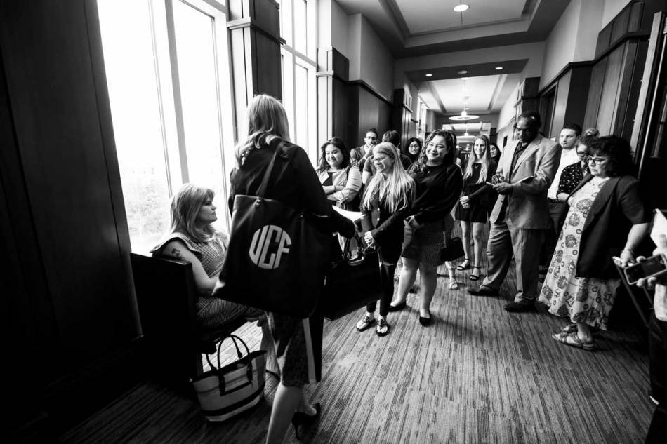 UCF students who worked on the petition gather in support of Juleigh Mayfield (seated by the window) after her hearing Jan. 15 at the Osceola County Courthouse. (Photo by Nick Leyva '15)